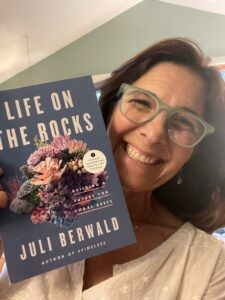 Juli holding galley of Life on the Rocks
